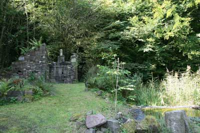ruined folly by pond