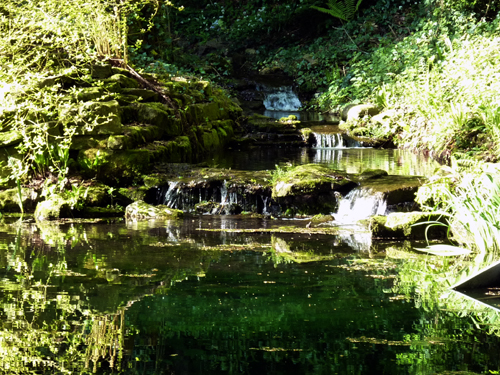 Water feature of stream, waterfalls and large pond